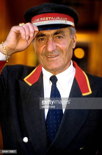 A Turkish doorman in front of the turkish restaurant Hasir