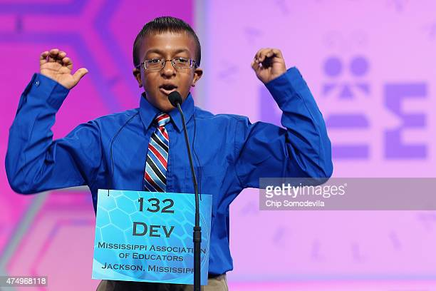 Dev Jaiswal of Jackson Mississippi reacts after correctly spelling his word during the 88th Scripps National Spelling Bee semifinals at the Gaylord...