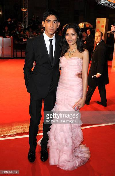 Dev Patel and Freida Pinto wearing a dress by Oscar de la Renta at the 2009 British Academy Film Awards at the Royal Opera House in Covent Garden...