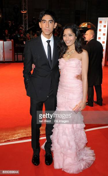 Dev Patel and Freida Pinto wearing a dress by Oscar de la Renta arrive for the 2009 British Academy Film Awards at the Royal Opera House in Covent...