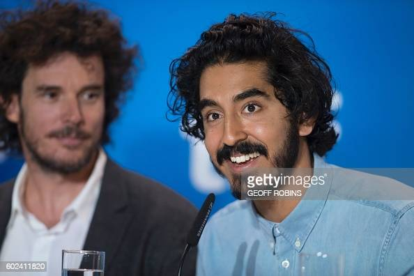 Dev Patel speaks as director Garth Davis looks on during the press conference for their film 'Lion' at the Toronto International Film Festival in...