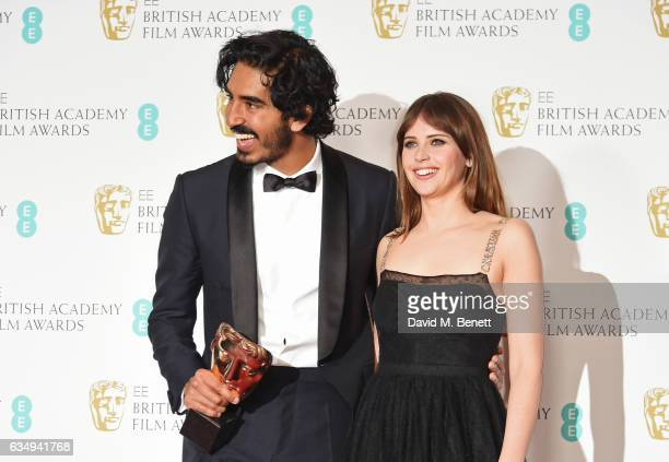 Dev Patel winner of the Supporting Actor award for 'Lion' and presenter Felicity Jones pose in the winners room at the 70th EE British Academy Film...
