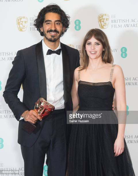 Dev Patel winner of the Supporting Actor award for 'Lion' poses with Felicity Jones poses in the winners room at the 70th EE British Academy Film...