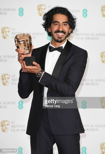 Dev Patel winner of the Supporting Actor award poses in the winners room at the 70th EE British Academy Film Awards at the Royal Albert Hall on...
