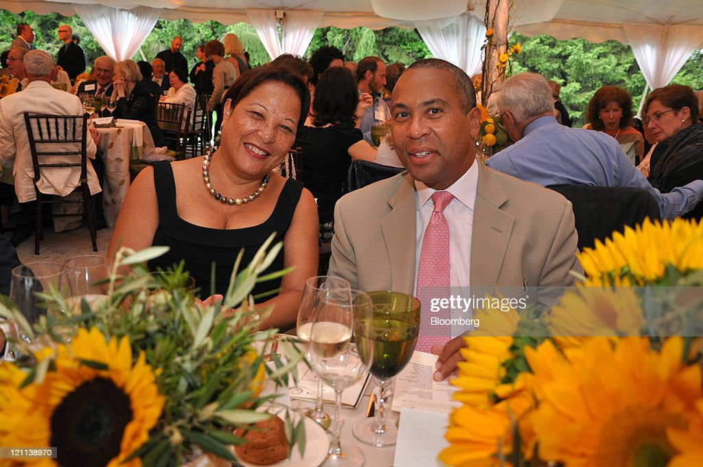 Deval Patrick governor of Massachusetts right and his wife Diane Patrick sit for a photograph at Tanglewood in Lenox Massachusetts US on Friday July...