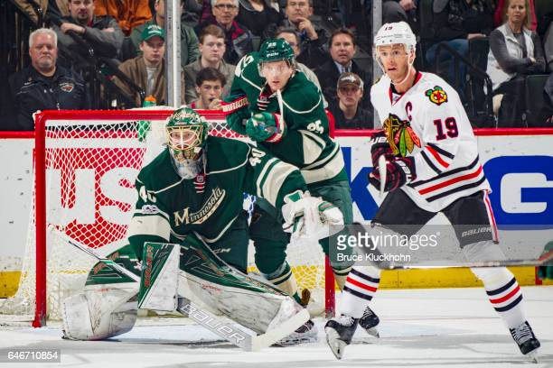 Devan Dubnyk and Jonas Brodin of the Minnesota Wild defend their goal against Jonathan Toews of the Chicago Blackhawks during the game on February 21...