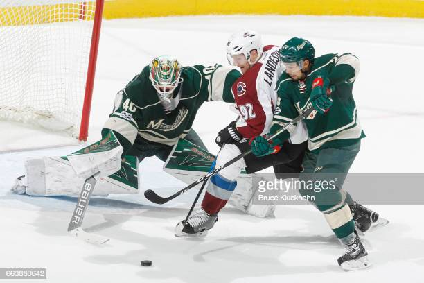 Devan Dubnyk and Matt Dumba of the Minnesota Wild defend their goal against Gabriel Landeskog of the Colorado Avalanche during the game on April 2...