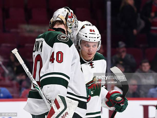 Devan Dubnyk and Mikael Granlund of the Minnesota Wild celebrate after defeating the Montreal Canadiens in the NHL game at the Bell Centre on March...