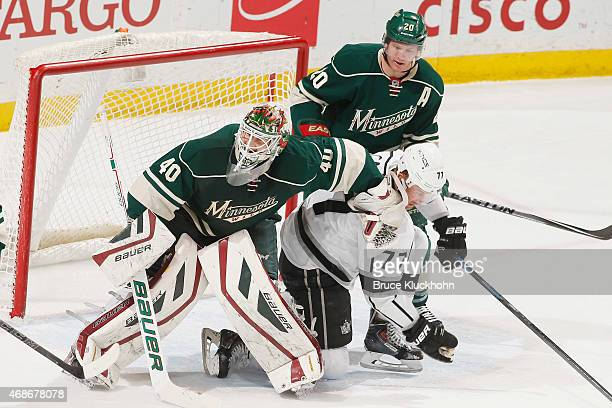 Devan Dubnyk and Ryan Suter of the Minnesota Wild defend their goal against Jeff Carter of the Los Angeles Kings during the game on March 28 2015 at...