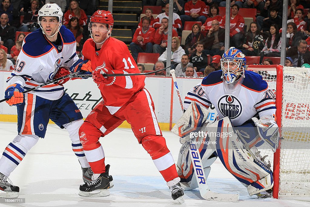 Devan Dubnyk of the Edmonton Oilers follows the play as teammate Justin Schultz defends Dan Cleary of the Detroit Red Wings during an NHL game at Joe...