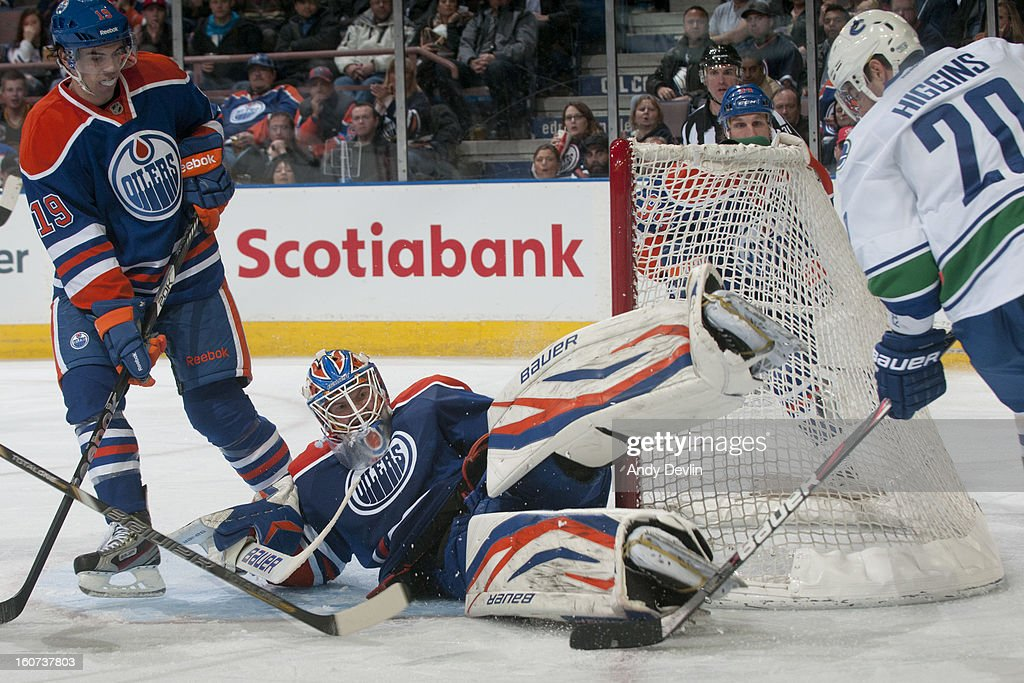 Devan Dubnyk #40 of the Edmonton Oilers makes a big save in third period action on Chris Higgins #20 of the Vancouver Canucks on February 4, 2013 at Rexall Place in Edmonton, Alberta, Canada.