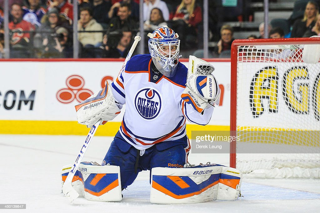 <a gi-track='captionPersonalityLinkClicked' href=/galleries/search?phrase=Devan+Dubnyk&family=editorial&specificpeople=2089794 ng-click='$event.stopPropagation()'>Devan Dubnyk</a> #40 of the Edmonton Oilers makes a glove save against the Calgary Flames during an NHL game at Scotiabank Saddledome on November 16, 2013 in Calgary, Alberta, Canada.