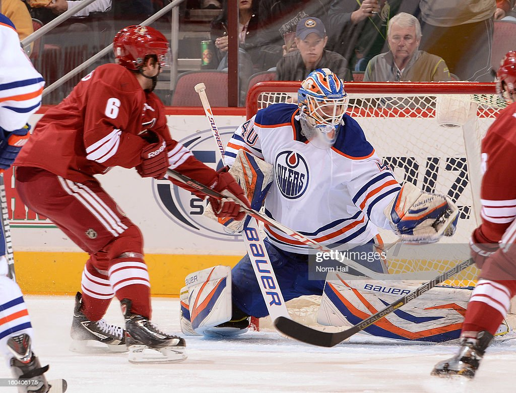 <a gi-track='captionPersonalityLinkClicked' href=/galleries/search?phrase=Devan+Dubnyk&family=editorial&specificpeople=2089794 ng-click='$event.stopPropagation()'>Devan Dubnyk</a> #40 of the Edmonton Oilers makes a glove save as <a gi-track='captionPersonalityLinkClicked' href=/galleries/search?phrase=David+Schlemko&family=editorial&specificpeople=3144738 ng-click='$event.stopPropagation()'>David Schlemko</a> #6 of the Phoenix Coyotes looks for a rebound at Jobing.com Arena on January 30, 2013 in Glendale, Arizona.