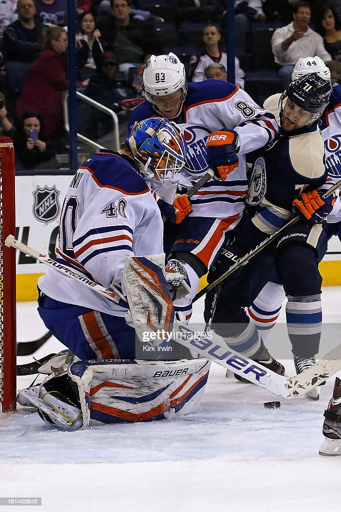 Devan Dubnyk #40 of the Edmonton Oilers makes a save as Ales Hemsky #83 of the Edmonton Oilers blocks Nick Foligno #71 of the Columbus Blue Jackets from getting to any possible rebound during the second period on February 10, 2013 at Nationwide Arena in Columbus, Ohio.