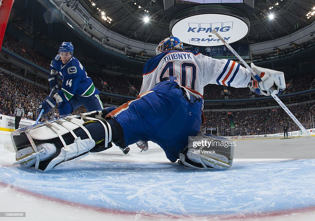 Devan Dubnyk #40 of the Edmonton Oilers makes a shootout save on Alexandre Burrows #14 of the Vancouver Canucks during their NHL game at Rogers Arena January 20, 2013 in Vancouver, British Columbia, Canada. Edmonton won 3-2 in a shootout.