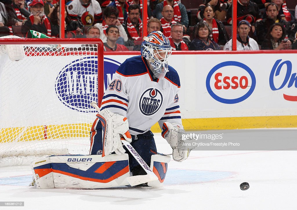 <a gi-track='captionPersonalityLinkClicked' href=/galleries/search?phrase=Devan+Dubnyk&family=editorial&specificpeople=2089794 ng-click='$event.stopPropagation()'>Devan Dubnyk</a> #40 of the Edmonton Oilers makes one of thirty-five saves against the Ottawa Senators during an NHL game at Canadian Tire Centre on October 19, 2012 in Ottawa, Ontario, Canada.