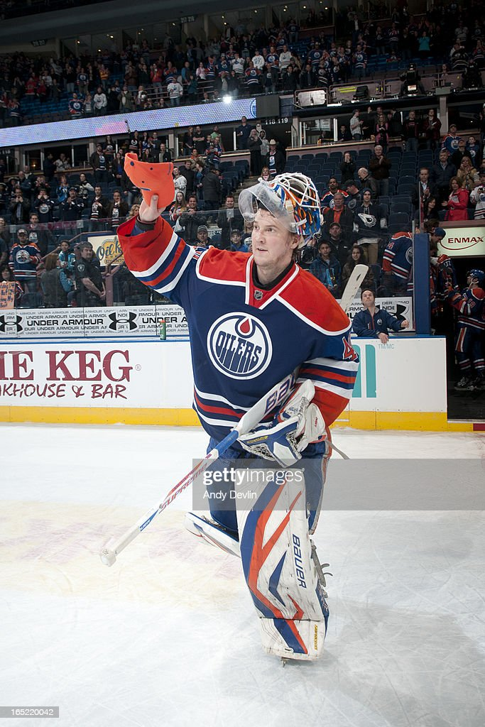<a gi-track='captionPersonalityLinkClicked' href=/galleries/search?phrase=Devan+Dubnyk&family=editorial&specificpeople=2089794 ng-click='$event.stopPropagation()'>Devan Dubnyk</a> #40 of the Edmonton Oilers salutes the crowed after being selected the game's first star against the Calgary Flames on April 1, 2013 at Rexall Place in Edmonton, Alberta, Canada.