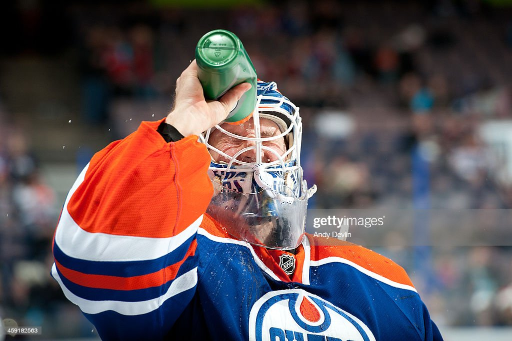 Devan Dubnyk #40 of the Edmonton Oilers sprays himself with a water bottle prior to a game against the Winnipeg Jets on December 23, 2013 at Rexall Place in Edmonton, Alberta, Canada.