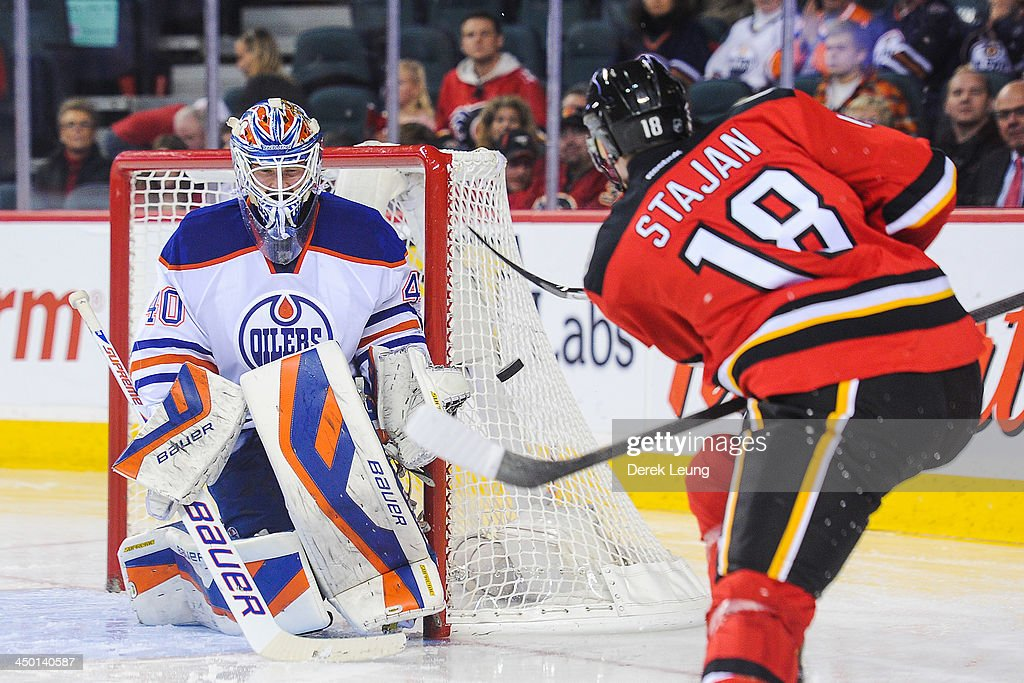 <a gi-track='captionPersonalityLinkClicked' href=/galleries/search?phrase=Devan+Dubnyk&family=editorial&specificpeople=2089794 ng-click='$event.stopPropagation()'>Devan Dubnyk</a> #40 of the Edmonton Oilers stops the shot of Matt Stajan #18 of the Calgary Flames during an NHL game at Scotiabank Saddledome on November 16, 2013 in Calgary, Alberta, Canada.