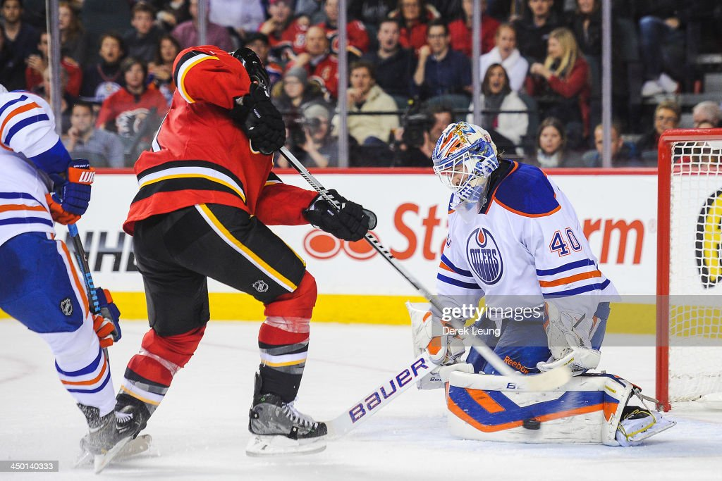 <a gi-track='captionPersonalityLinkClicked' href=/galleries/search?phrase=Devan+Dubnyk&family=editorial&specificpeople=2089794 ng-click='$event.stopPropagation()'>Devan Dubnyk</a> #40 of the Edmonton Oilers stops the shot of <a gi-track='captionPersonalityLinkClicked' href=/galleries/search?phrase=Mikael+Backlund&family=editorial&specificpeople=4324942 ng-click='$event.stopPropagation()'>Mikael Backlund</a> #11 of the Calgary Flames during an NHL game at Scotiabank Saddledome on November 16, 2013 in Calgary, Alberta, Canada.