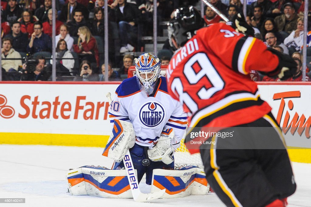 <a gi-track='captionPersonalityLinkClicked' href=/galleries/search?phrase=Devan+Dubnyk&family=editorial&specificpeople=2089794 ng-click='$event.stopPropagation()'>Devan Dubnyk</a> #40 of the Edmonton Oilers stops the shot of <a gi-track='captionPersonalityLinkClicked' href=/galleries/search?phrase=T.J.+Galiardi&family=editorial&specificpeople=4324979 ng-click='$event.stopPropagation()'>T.J. Galiardi</a> #39 of the Calgary Flames during an NHL game at Scotiabank Saddledome on November 16, 2013 in Calgary, Alberta, Canada.
