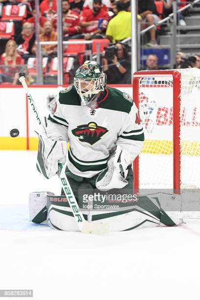 Devan Dubnyk of the Minnesota Wild blocks this shot during the Detroit Red Wings game versus the Minnesota Wild on October 5 at Little Caesars Arena...