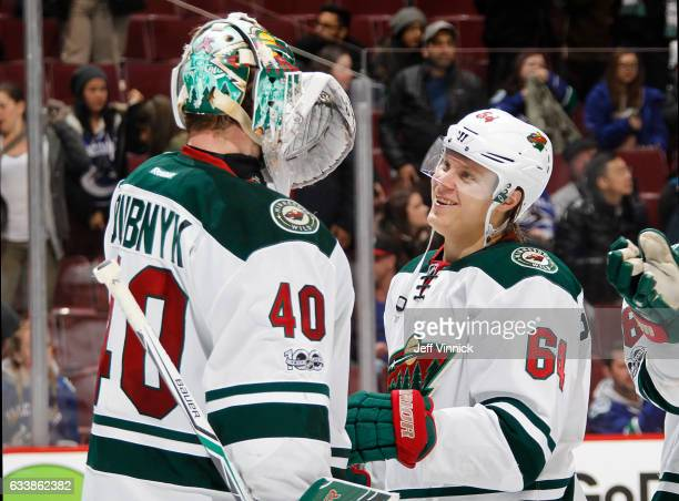 Devan Dubnyk of the Minnesota Wild congratulates teammate Mikael Granlund after their NHL game at Rogers Arena against the Vancouver Canucks February...