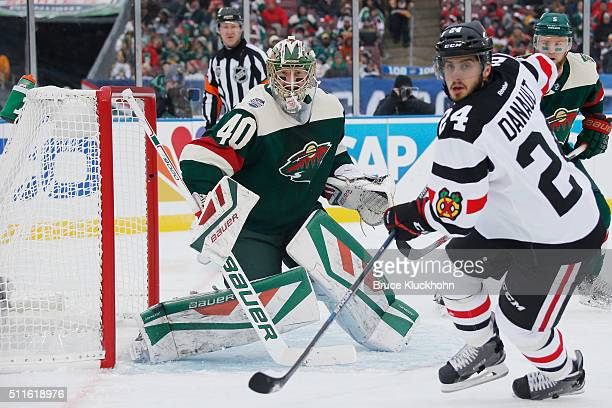 Devan Dubnyk of the Minnesota Wild defends his goal against Phillip Danault of the Chicago Blackhawks during the 2016 Coors Light NHL Stadium Series...