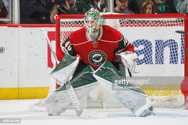 Devan Dubnyk of the Minnesota Wild defends his goal against the Carolina Hurricanes during the game on April 4 2017 at the Xcel Energy Center in St...