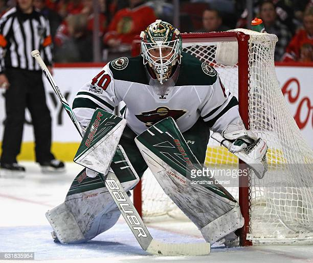 Devan Dubnyk of the Minnesota Wild follows the action against the Chicago Blackhawks at the United Center on January 15 2017 in Chicago Illinois The...