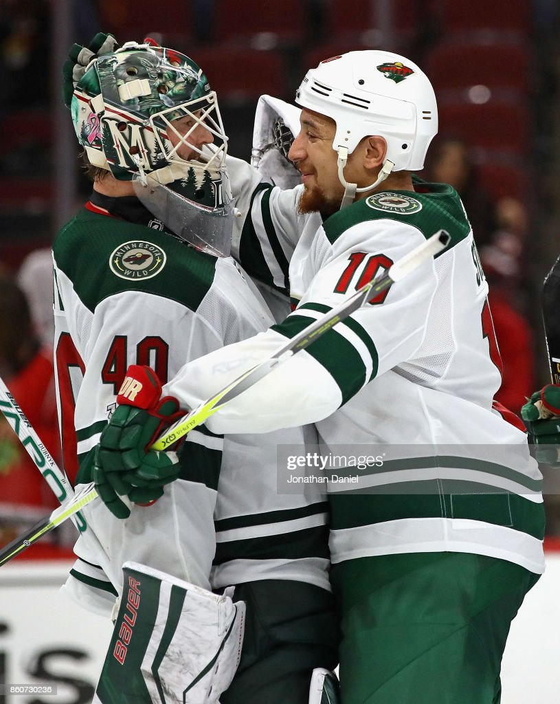 Devan Dubnyk #40 of the Minnesota Wild is congratulated by teammate Chris Stewart #10 after a win over the Chicago Blackhawks at the United Center on October 12, 2017 in Chicago, Illinois. The Wild defeated the Blackhawks 5-2.