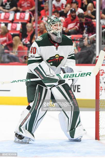 Devan Dubnyk of the Minnesota Wild looks for the puck during the Detroit Red Wings game versus the Minnesota Wild on October 5 at Little Caesars...