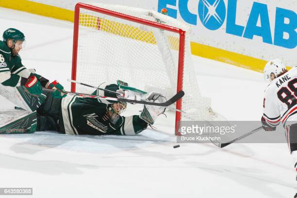 Devan Dubnyk of the Minnesota Wild makes a diving save against Patrick Kane of the Chicago Blackhawks during the game on February 21 2017 at the Xcel...