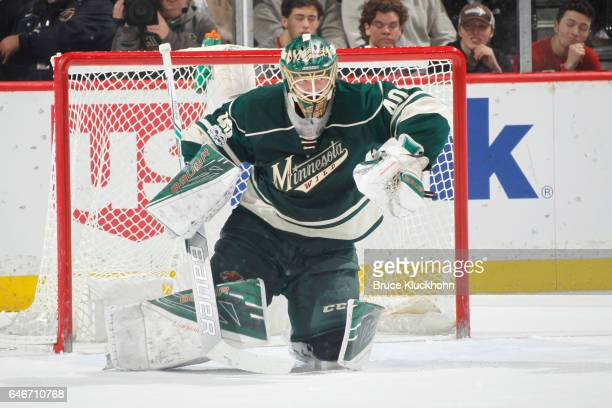 Devan Dubnyk of the Minnesota Wild makes a save against the Chicago Blackhawks during the game on February 21 2017 at the Xcel Energy Center in St...