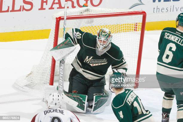 Devan Dubnyk of the Minnesota Wild makes a save against the Colorado Avalanche during the game on April 2 2017 at the Xcel Energy Center in St Paul...