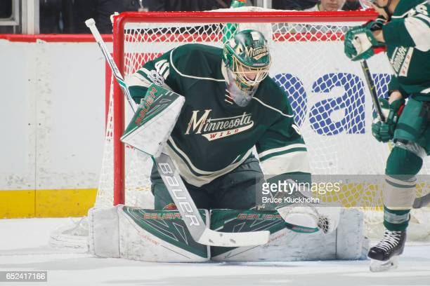 Devan Dubnyk of the Minnesota Wild makes a save against the San Jose Sharks during the game on March 5 2017 at the Xcel Energy Center in St Paul...