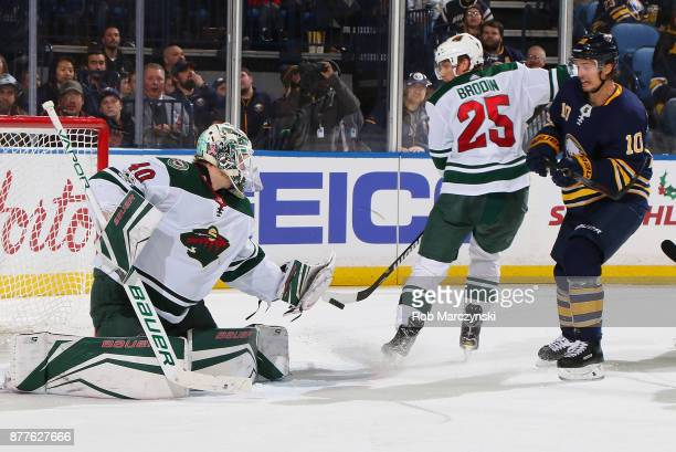 Devan Dubnyk of the Minnesota Wild makes a save as Jonas Brodin of the Wild and Jacob Josefson of the Buffalo Sabres look on during an NHL game on...