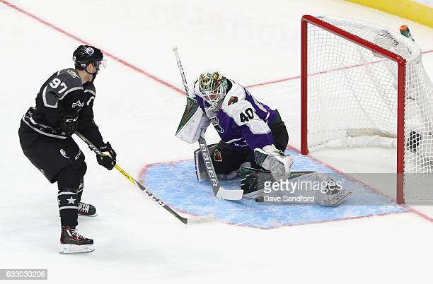 Devan Dubnyk of the Minnesota Wild makes a save on Connor McDavid of the Edmonton Oilers during the Central Division and Pacific Division matchup of...