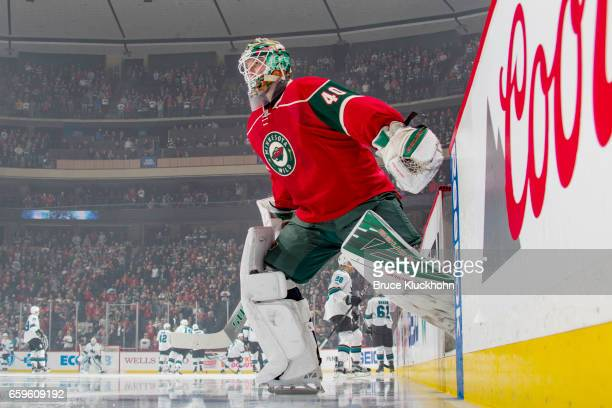 Devan Dubnyk of the Minnesota Wild makes his way onto the ice prior to the game against the San Jose Sharks on March 21 2017 at the Xcel Energy...