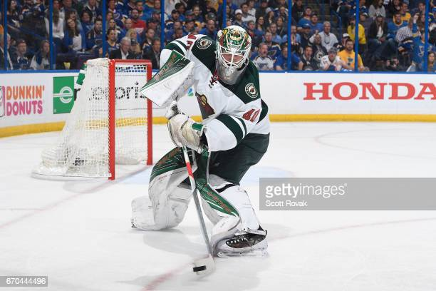 Devan Dubnyk of the Minnesota Wild passes the puck against the St Louis Blues in Game Four of the Western Conference First Round during the 2017 NHL...