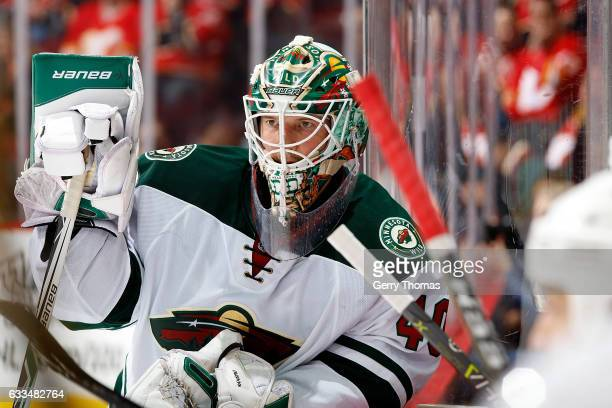 Devan Dubnyk of the Minnesota Wild stands by the bench during an NHL game against the Calgary Flames on February 1 2017 at the Scotiabank Saddledome...
