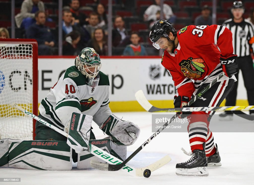 Devan Dubnyk #40 of the Minnesota Wild stops a shot by Ryan Hartman #38 of the Chicago Blackhawks at the United Center on October 12, 2017 in Chicago, Illinois. The Wild defeated the Blackhawks 5-2.