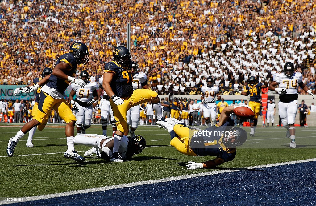 Devante Downs of the California Golden Bears dives in for a touchdown after making an interception against the Grambling State Tigers at California...