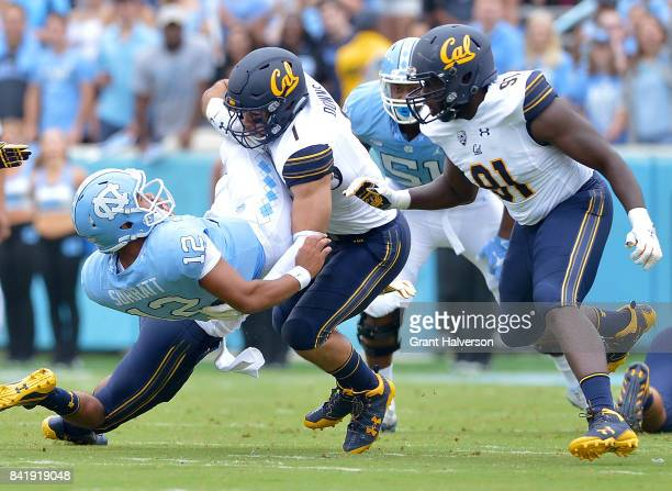 Devante Downs of the California Golden Bears tackles Chazz Surratt of the North Carolina Tar Heels during their game at Kenan Stadium on September 2...