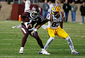 De'Vante Harris of the Texas AM Aggies picks off a pass in front of Travin Dural of the LSU Tigers in the first half of their game at Kyle Field on...