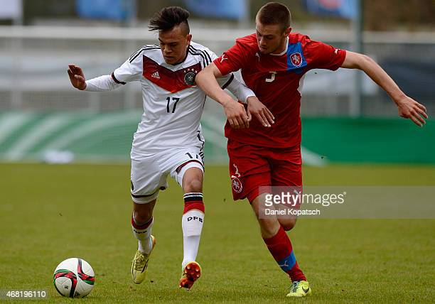 Devante Parker of Germany is challenged by Miroslav Routek of Czech Republic during the UEFA Under19 Elite Round match between Germany and Czech...