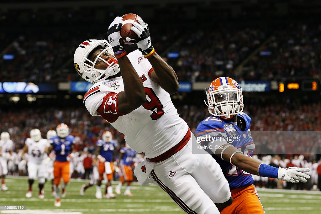 DeVante Parker #9 of the Louisville Cardinals catches a second quarter touchdown pass over Loucheiz Purifoy #15 of the Florida Gators during the Allstate Sugar Bowl at Mercedes-Benz Superdome on January 2, 2013 in New Orleans, Louisiana.