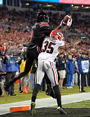 DeVante Parker of the Louisville Cardinals makes a touchdown catch over Aaron Davis of the Georgia Bulldogs during the Belk Bowl at Bank of America...