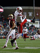 DeVante Parker of the Louisville Cardinals scores a touchdown against the Boston College Eagles in the second quarter at Alumni Stadium on November 8...