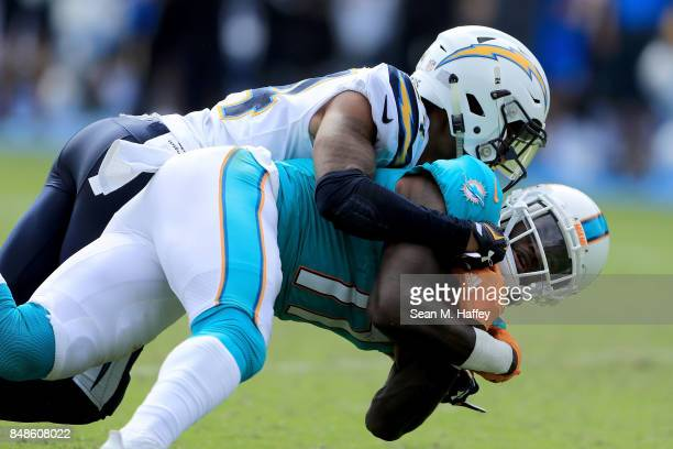 DeVante Parker of the Miami Dolphins makes a reception as Trevor Williams of the Los Angeles Chargers defends during the second half of a game at...